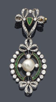 Early 20th century diamond, emerald and pearl pendant/brooch, circa 1910.