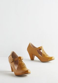 Picture of Poetic Heel in Saffron. Always poised and mild-mannered, you look especially proper in these T-strap heels by Chelsea Crew! #yellow #modcloth