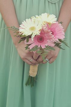 This would be so pretty with more pink daisies and a couple of white orchids added in and these for Bridesmaid bouquets made all in pink!