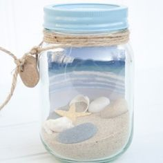 Beach in a jar. Fun way to display your vacation treasures. Collect sand/shells from your favorite beaches.