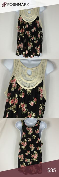 """Boho Casual Top Boho Casual Top  NWOT Top with embroidered yoke. Made in the USA. 96% rayon 4% spandex Hand wash cold hang to dry.   Small bust 40"""" length 28""""   Medium bust 44"""" length 28""""  Large bust 46"""" length 28""""  All measurements are approximate. Tops"""