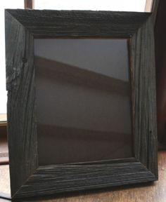 Black reclaimed wood frame.  Burnt or painted?