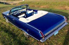 OMG - Blue convertable 1966 Plymouth Valiant with white interior!