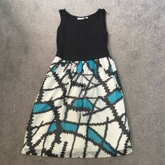 Adorable printed dress with pockets Adorable NY & Co black tank dress with printed bottom. Pockets at hips. Worn only once. Can be dressed up or down. Also looks cute with a belt added but def not needed. New York & Company Dresses
