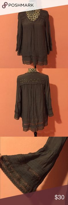 Calypso St Barth Gray Bell Sleeve Tunic Blouse XS • Calypso St. Barth Gray Tunic in size XSmall. • Blouse is made of 100% Viscose. • Features a lace accents around the yoke and sleeves, bell sleeves. • Gently used and pre-owned, blouse is a mint condition. Lace hem does show signs of fading. There is also a 1/2 inch hole under the armpit area of the left sleeve and a 1 inch hole on the armpit area of the right sleeve. Very small and can be fixed. • Measurements (taken laying flat): Bust 19…