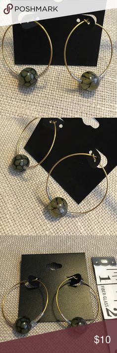 Baltic Stone Gold Hoops Large Baltic stone gold tone hoop earrings. Earrings are a tad heavier than regular hoops might be. New, handmade and never been worn. Smoke free home. Jewelry Earrings