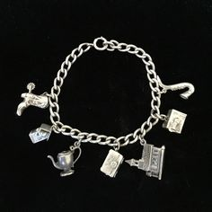 Antique charm bracelet Truly charming antique charm bracelet. STERLING SILVER. Charms include a cowboy boot with spur, birdhouse, teapot (missing the top), hope chest, church, Houdini box and saxophone. (EX) Vintage Jewelry Bracelets