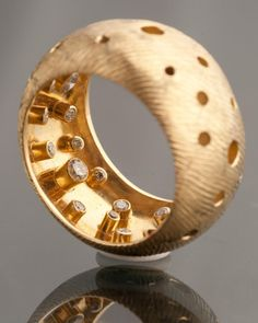 """Hollow ring with secret diamonds. I have seen wedding bands with a single hidden diamond on th einside before. This is so understated it moves from cool to absofuckingfabulous... Alan Revere - """"implosion"""" ring - gold, diamonds"""