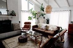 For all you lovelies witha penchant for interior design, have we got a treat foryou today!! Wedding photographers,Matt + Tish, have invited us into their modern + bohemian-inspired abode, and we've got to say — it's Pinterest perfection!! Mid-century modern touches decorate their space, lots of greenery is incorporated, along with fun + funky boho...