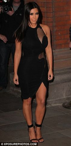 0629773cb3 provocative  Kim Kardashian looked sexy in a cutaway mesh dress as attended  a QuickTrim party in London tonight