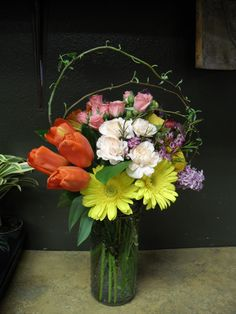 yellow, orange, pink flowers arrangement for wedding and events.