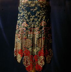Black silk dress with red and gold embroidery (detail), probably European, 1926. Tirelli Trappetti Foundation.