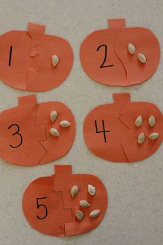 Pumpkin Seed Puzzles  Happy Halloween!  Use your leftover pumpkin seeds from jack-o-lantern making to make these pumpkin seed puzzles.  This is great for number recognition and one-to-one correspondence.