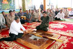"""""""Cambodia's Prime Minister Samdech Akka Moha Sena Padei Techo Hun Sen cuts white sacred thread this morning while he was presiding over the inauguration ceremony of a new temple at Ampil Vorn pagoda at Thpong district, Kampong Speu province."""""""