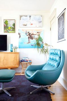 Blue leather chair with gallery wall of artwork