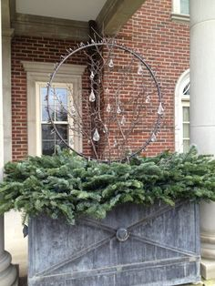 Light rings, branches, glass drops, on a nest of evergreens from Deborah Silver. Christmas Window Boxes, Front Door Christmas Decorations, Christmas Porch, Christmas Wreaths, Christmas 2017, Christmas Ideas, Container Plants, Container Gardening, Twig Lights