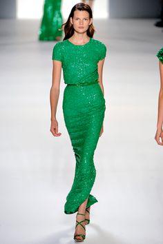 Love anything emerald. Reminds me a lotttt of Angelina Jolie's Golden Globes 2011 dress!