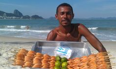 Beach vendor at Copacabana Beach, Rio de Janeiro. So I had heard all about the good beach food at Copacabana, but I never expected how delicious it would be! This man was one of the few selling shrimp. Three skewers for 15 reals and I was in taste bud heaven. Lime juice and salt are added to the top and everything you see is fair game to eat. Having this gorgeous view of the beach and Sugarloaf in the background makes the experience even better.