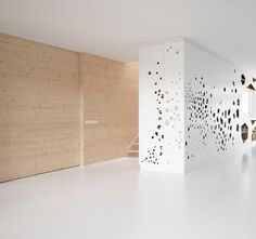 apartment with laser cut facets in wood. so beautiful. (by i29 architects)