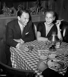 Entertainers Frank Sinatra and Laruen Bacall have a drink and a smoke at Musso And Frank Grill in 1957 in Hollywood, California.
