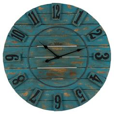 Awash in a distressed ocean blue finish and featuring a planked wood design, this charming wall clock brims with rustic-chic appeal.