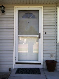 Storm Door Makeover: I again found brassy gold accents that I knew I had to tackle. http://keepcalmcreate.blogspot.com/2013/05/storm-door-makeover.html