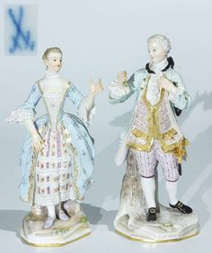 """Rococo group of figures. MEISSEN 1870 -1880, first class. Model no. A 56, A 58. """"lady with fan"""" and """"cavalier with Rose"""". Colored painted, golden decorated. On flat base standing. Fan and Rose broken off, small Beschädig., restorations. Height approximate 19.5 cm. Blue sword brand, scratch mark, painters mark.  Dealer Auktionshaus Rütten  Auction Minimum Bid: 500.00EUR"""