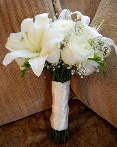 All white bouquet with lilies and a navy blue ribbon. :) … | Wedding …