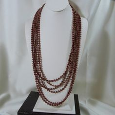 Check out this item in my Etsy shop https://www.etsy.com/listing/116799594/rust-6-strand-freshwater-pearl-and
