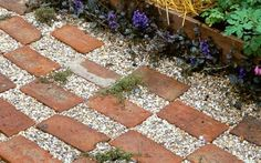 Pics: 10 ideas for paths for next year's garden design here brick and gravel path. From the paths board