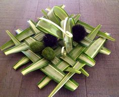 Weaving of Yucca leaves to create a platter design.  Uploaded and designed by Marjorie's Bouquet Designer Florist