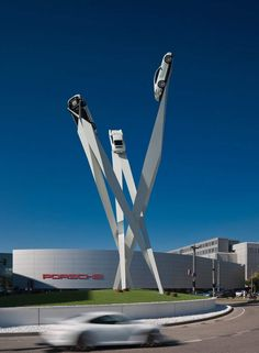 Porsche 911s steel frame sculpture by Gerry Judah (6)-Outside Porche museum in Stuttgart,a giant sculpture with three real size 911 sports cars appearing to soar up into the sky.