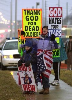 I won't even comment on this photo - I believe in the 1st Amendment but...there's a difference between what you have a RIGHT to do and what is MORALLY acceptable to do. You make the call. These people are from the Westboro Baptist Church aka Reverend Fred Phelps