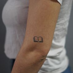 Boc Tattoo SemiPermanent Tattoos by inkbox™ is part of Book tattoo - Boc by inkbox o Dimensions 1 0 x 0 6 inches Let us remember One book, one pen, one child, and one teacher can change the world Malala Yousafzai Tiny Tattoos For Girls, Cool Small Tattoos, Small Tattoo Designs, Tattoo Designs Men, Tattoos For Guys, Cool Tattoos, Tatoos, Awesome Tattoos, Bookish Tattoos