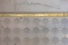 Detail This special bathroom features our Arpell pattern from the Vetromarmi Collection, La Leaf Gold Leaf glass liner, Arctic White polished porcelain and Calacatta Gold.  Simply elegant!