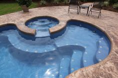 Saltwater fiberglass swimming pool by Dolphin Pools of West Monroe. Viking Pools Trilogy Pools. Spa with spillover with Rico Rock waterfall Pentair IC40 salt water system