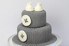 Knitted baby cake by Cakes For Show