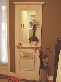 """Antique 2-panel door reclaimed from an old house. A mirror has been installed. The shelf, newspaper bin and moldings are made of pine. Original paint is left on the door and the added bits are hand painted and antiqued with eco-friendly paints and stains.  [More examples of """"Upcycled, Vintage and Antique Hall Trees"""" on the click-through.]"""