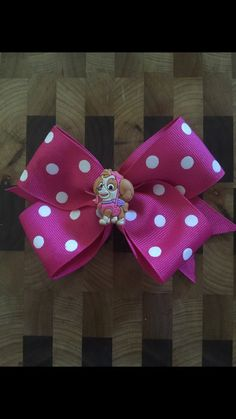 Paw Patrol Skye Inspired Girls Hair Bow handmade by Smoochie Mamas! This bow can be worn on either side of the head   All ribbon ends are heat sealed to prevent fraying.  Thanks for looking!     ********PLEASE NOTE!!******** I do not claim ownership over the characters or images used, such images are free and are NOT being sold! The price you are paying is for my time creating these items and the materials used. The Copyright solely belong to their respective copyright holders.
