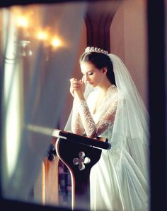 I can't get over how beautiful this is. The dress, the praying, the veil, oh my.