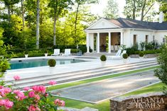The pool was completely updated, and a bocce ball court was a part of the redesign. Boxwoods give a structed look to the garden spaces while roses add an exuberant note. Outdoor Spaces, Outdoor Living, Bocce Court, Bluestone Patio, Enchanted Home, Atlanta Homes, Hamptons House, White Houses, Pool Houses