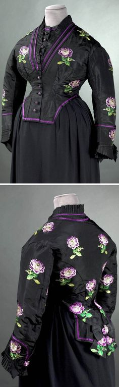 Robe à transformation, 1873. Black silk taffeta with roses embroidered on it in purple, green, & yellow silk and trimmed with black silk ribbons. Given by Empress Eugénie to the wife of the deposed emperor's doctor. (They were living in exile in Britain at this time.) Palais Galliera, Musée de la Mode de la Ville de Paris