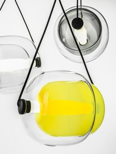 White Interior - Brokis lights - Smoke grey, amber, violet, dark smoke grey, yellow, transparent glass and opaline Capsula. Design by Lucie Koldova
