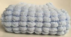 Pom pom baby blanket, blue baby blanket, Newborn photo prop, car seat blanket, moses basket blanket, stroller blanket, Hand knitted, by Katiebeesknits on Etsy