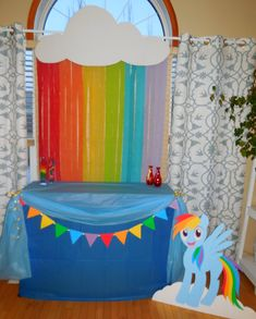This rainbow cloud and rainbow dash were so fun to make.  I cut a cloud out of a very large piece of white card stock.  Then taped streamers across the back of the cloud.  It made a beautiful back drop for the cake table.