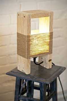 Cute Wood Table Lamp made with a Pallet Lovely wood lamp made with pallet parts and thin natural ropes.Fully handmade in Italy. Buy here The post Cute Wood Table Lamp made with a Pallet appeared first on Wood Diy. Table Lamp Wood, Wooden Lamp, Wooden Diy, Table Lamps, Diy Wood, Wood Wood, Handmade Wooden, Pallet Furniture, Furniture Design