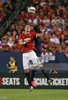 Morgan Schneiderlin of Manchester United and Hervin Ongenda of Paris Saint-Germain battle for a header during a match