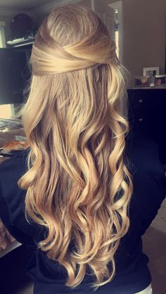 Prom half up half down style with lose curls