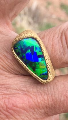 """A beautiful 22k cast ring with a """"rough"""" textured surface, carved and fabricated by Micky Roof, for Bill Kasso...The boulder Opal was cut by Bill Kasso.. #opalsaustralia"""
