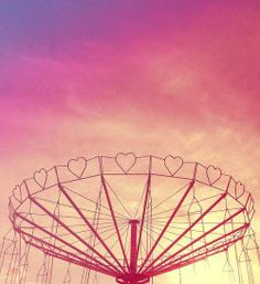 Heart carnival ride against night sky
